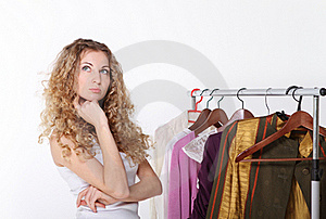Girl Selecting Clothes In Shop Stock Photo - Image: 18025190