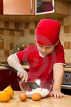 Small Boy In Kitchen With Baking Stock Image - Image: 18028121