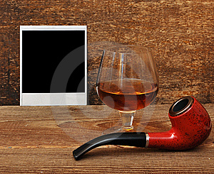 Old Photo, Pipe And Glass Of Cognac Royalty Free Stock Photography - Image: 18030577