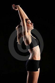 Woman In Sports Outfit Stretching Arms Above Head Royalty Free Stock Images - Image: 18036629