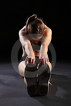 Woman Sitting On Floor Stretching To Touch Toes Royalty Free Stock Image - Image: 18036766