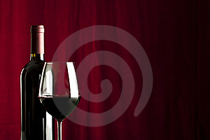 A Glass Of Red Wine And A Bottle Stock Image - Image: 18038371