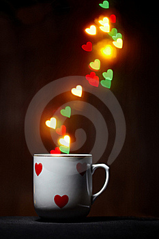 Cup With Steam Of Glowing Hearts On Dark Stock Image - Image: 18043241
