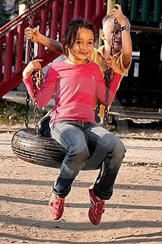 Boy And Girl On Swing Stock Images - Image: 18056214