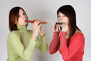 Two Girls Playing On Flute And Harp Royalty Free Stock Photo - Image: 18056255