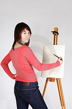 Girl Standing Near Easel And Painting Royalty Free Stock Photos - Image: 18056258