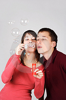 Man And Woman Blowing Out Soap Bubbles Stock Photos - Image: 18056313