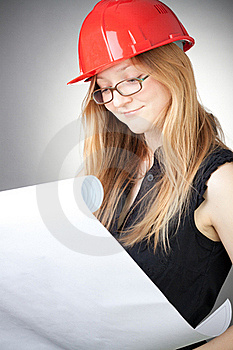 Young Engineer Woman In Helmet With Blueprint Stock Photos - Image: 18059353