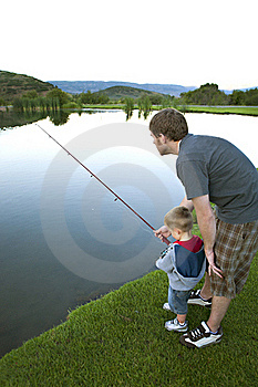 Father Teaching His Young Son To Fish. Royalty Free Stock Image - Image: 18060526