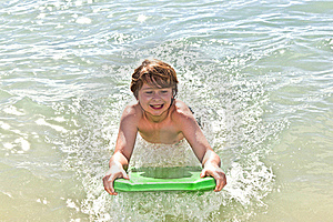 Boy Has Fun With The Surfboard Royalty Free Stock Photos - Image: 18077688