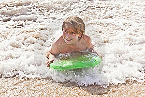 Boy Has Fun With The Surfboard Royalty Free Stock Photography - Image: 18077757