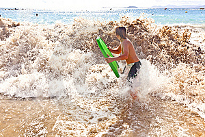 Boy Has Fun With The Surfboard Stock Images - Image: 18077824