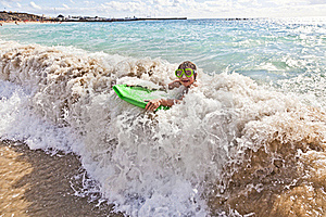 Boy Has Fun With The Surfboard Stock Image - Image: 18077911