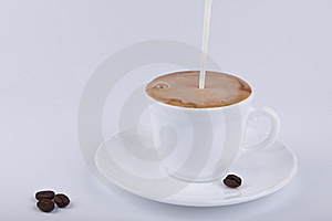 Pouring Milk Into Coffee Stock Photography - Image: 18084222