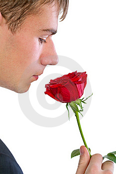 Man Smelling A Rose Stock Photo - Image: 18086300