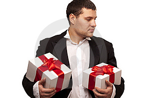 Gentleman With Gift Boxes Stock Photos - Image: 18093093
