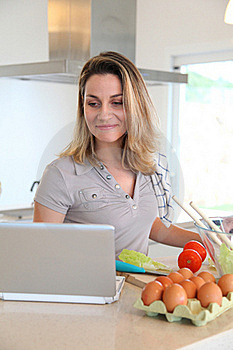 Woman In Kitchen Preparing Lunch Royalty Free Stock Photo - Image: 18096855