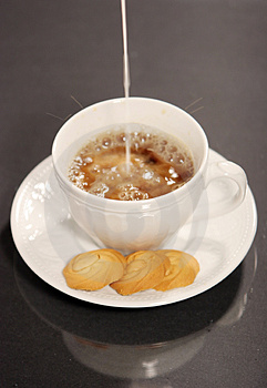 Pouring Milk Into Coffee And Cookies Stock Photos - Image: 1819053
