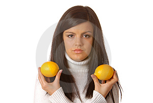 Attractive Brunette With Lemons Stock Photos - Image: 1819313