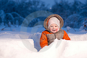 Adorable Baby Sit And Digging Hideout Hole In Snow Stock Image - Image: 18100711
