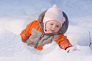 Cute Baby Sit In Snow In Forest And Dig Snow Stock Photos - Image: 18100783