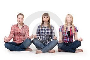 Three Girls Sitting In Lotus Posture Royalty Free Stock Photos - Image: 18118888