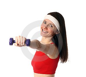 Happy Young Woman Exercising With A Dumbbell Stock Photo - Image: 18121370