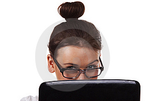 Woman With Glasses Sits And Working On Laptop Royalty Free Stock Photo - Image: 18130165