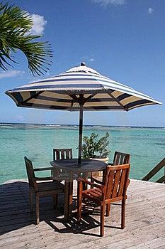 Caribbean Beach Table Under A Palm Tree Stock Photos - Image: 18142343