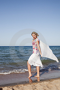Girl Standing With Waving A Scarf Stock Images - Image: 18143024
