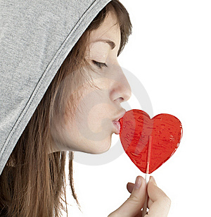 Candy Red Heart In The Girl's Lips Stock Photos - Image: 18158133