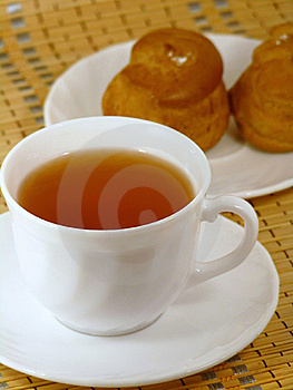 Brewing Delicious Cake With Cream And A Cup Of Tea Royalty Free Stock Photo - Image: 18169655