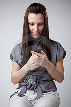 Woman Using A Mobile Phone Stock Photography - Image: 18174242