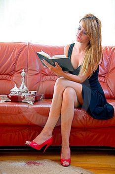 Woman Reading A Book On The Sofa Stock Images - Image: 18179354