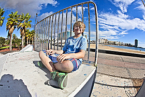 Cute Boy Sitting At The Skate Park Royalty Free Stock Photo - Image: 18189645