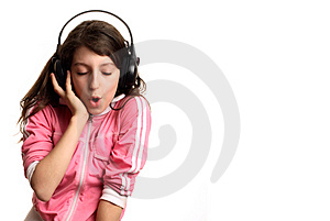 The girl listens to music Royalty Free Stock Photography
