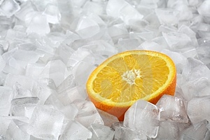 Orange on ice Royalty Free Stock Images