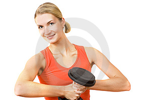Blond girl with heavy dumbbell