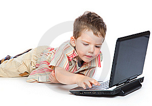 A Cute Boy Is Typing On A Laptop Stock Photography - Image: 18215182