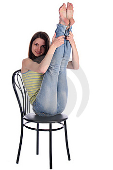Girl Sit On Stool Take Legs Up. Royalty Free Stock Images - Image: 18225469