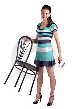 Girl In Stripy Blue Dress Holds Stool. Stock Image - Image: 18226061