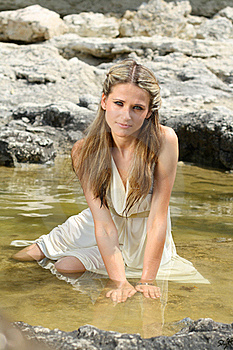Attractive Young Woman Sitting In The Water Stock Photo - Image: 18226540