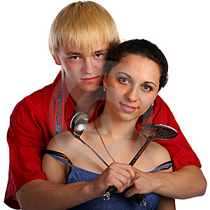 Young Man And Woman Embraces With Utensil Royalty Free Stock Images - Image: 18227949