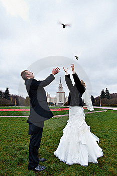 Happy Bride And Groom And Pigeons Royalty Free Stock Photo - Image: 18232225