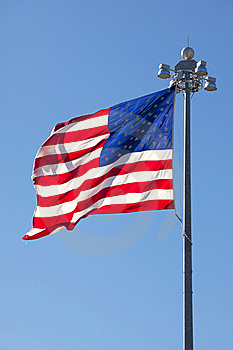 United States Flag In Front Of Clear Blue Sky Royalty Free Stock Photography - Image: 18246927