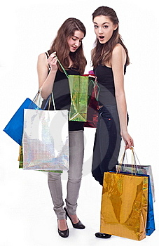 Image Of Two Girls With Their Purchases. Royalty Free Stock Images - Image: 18250929
