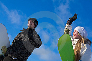 Young Smiling Couple With Snowboards Royalty Free Stock Images - Image: 18258169