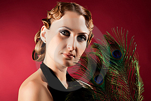 Portrait Of Elegant Woman Holding Feather Stock Photo - Image: 18284320