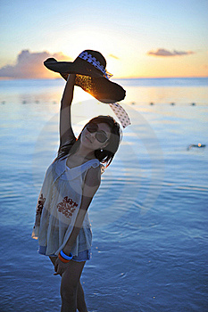 Girl In Sunset With A Straw Hat Stock Image - Image: 18284411