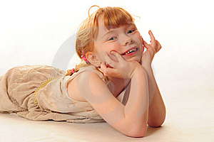 Cute Little Girl Lying On Floor Royalty Free Stock Photography - Image: 18290537